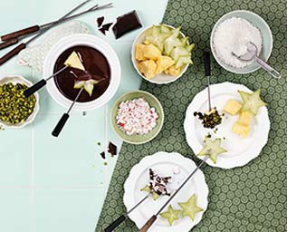 Chokladfondue med frukt och strössel
